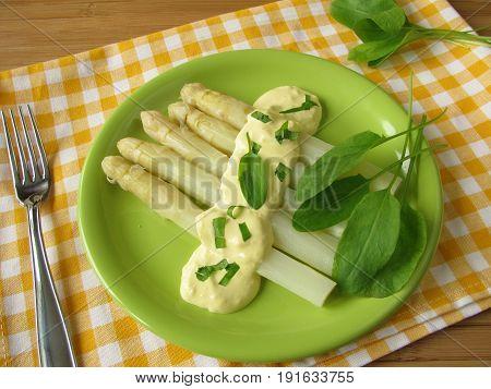 White asparagus with sorrel herbs hollandaise sauce