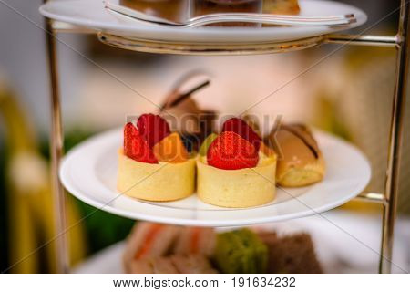 three tier afternoon tea set and pastries