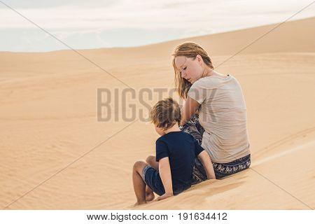 Mom And Son In The Desert. Traveling With Children Concept