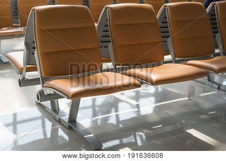 Empty chairs in the departure hall at airport