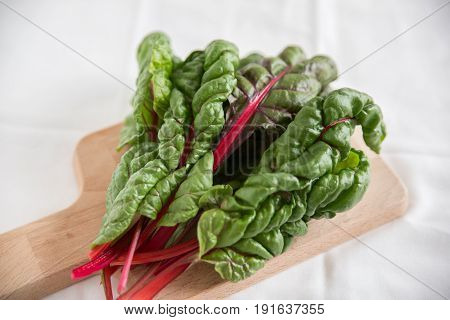 Stack of Rainbow Chard Leaves on a table