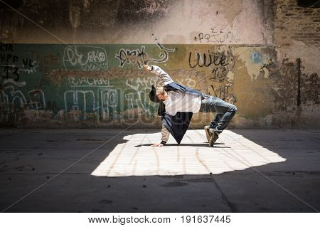 Breakdancer Performing In An Urban Setting