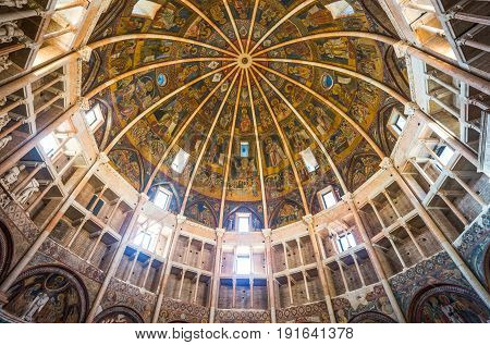 Parma, Italy - November 29, 2013: Frescoes, paintings and sculptures, in the baptistery of the basilica cathedral