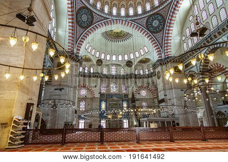 ISTANBUL, TURKEY - MAY 2, 2017: Interior of Suleymaniye Mosque in Istanbul, Turkey. The mosque was constructed by Sinan for sultan Suleyman the Magnificent