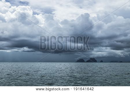 dark blue storm rain cloudscape at Amandan sea near Koh Mook, Thailand