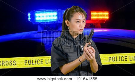 Asian American Policewoman With A Pistol