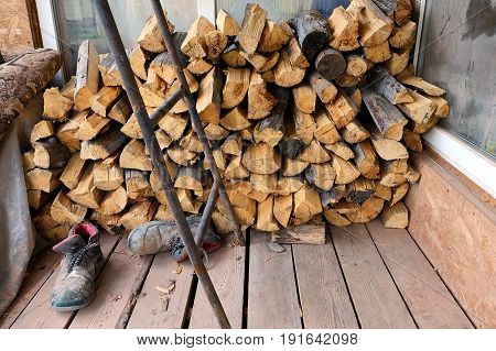 firewood for sauna stacked around the house