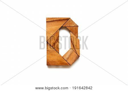 Wooden tangram puzzle as English alphabet letter