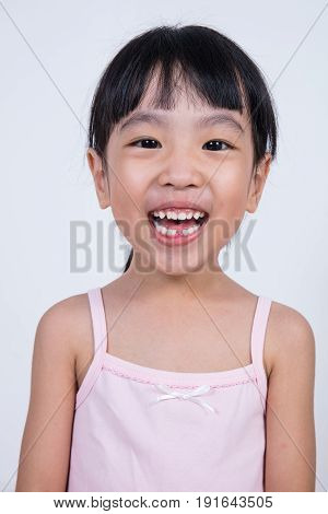 Happy Asian Chinese Little Girl With Toothless Smile