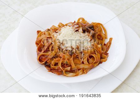 Penne with tomato sauce and vegetables. Penne pesto