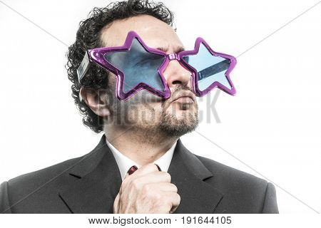 Businessman with pop star glasses screaming nervous and anxious for money