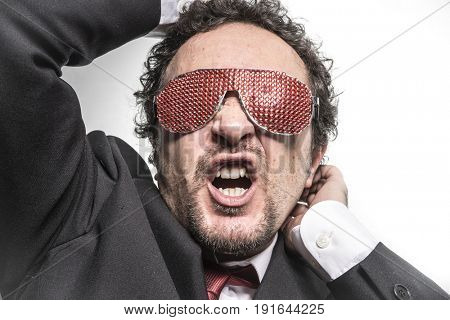 Businessman with red glasses screaming nervously and anxious for money