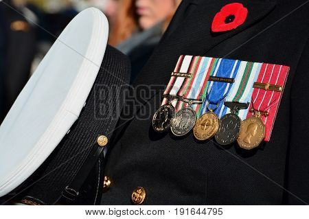 Victoria BC,Canada,November 11th 2014.A war veteran proudly displays his medals on his uniform on Remembrance day
