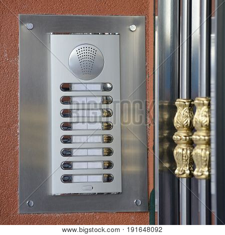 image of intercom on the wall close up