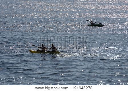 image of people canoeing in the sea