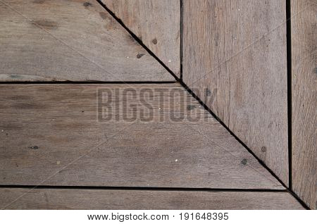 Brown wood slat floor at the corner fasten with nail