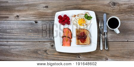 Morning breakfast meal on old wooden table in flat lay view