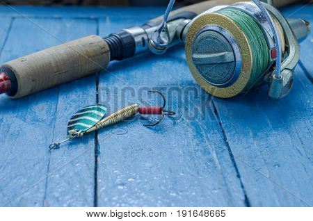 Spinning And Iron Bait For Fishing. Spoon. Water Drops. Decorative Background.