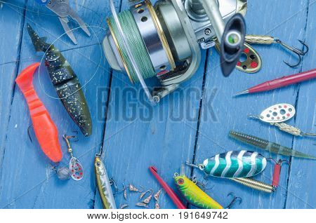 Fishing Lures And Fishing Reel With Tools. Top View.