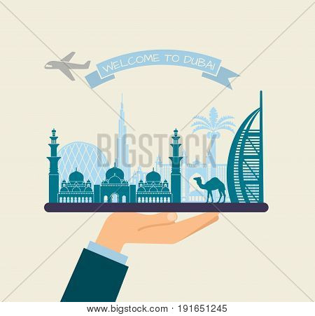The hand holds the sights of Dubai on a tray. The plane and the words welcome to Dubai on the ribbon