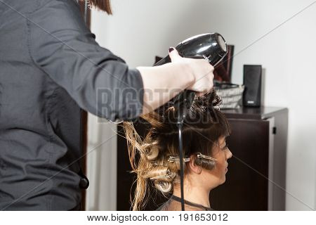 Close up of Woman at hairsalon getting luxury treatment. Professional service. New hairstyle. Stylist at work