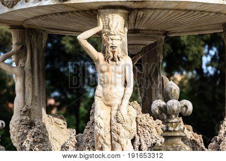 Italy, Rome - April , 29, 2013: Villa Doria Pamphili and its secret gardens. Fontain by Bernini named Cochlea in Villa Doria Pamphili. Largest and one of the most picturesqueroman park