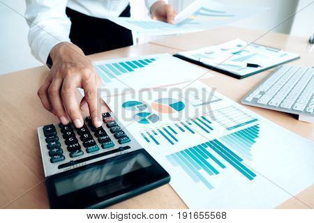 Finances Saving Economy Concept. Female Accountant Or Banker Use Calculator.