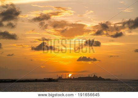 Beautiful sunset over the Gove Operations Bauxite Mine Alumina Refinery in Gove peninsula in the northern territory, Australia.