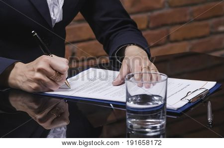 Close-up of Businesswoman signing job contract in office