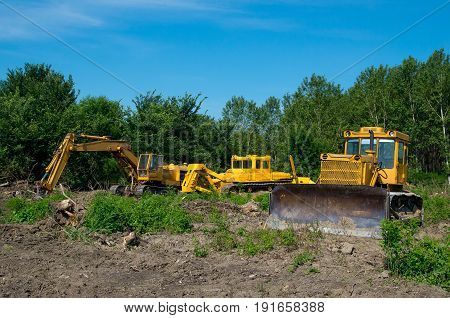 Mechanical Site Preparation for Forestry. Excavator and bulldozer clearing forest land