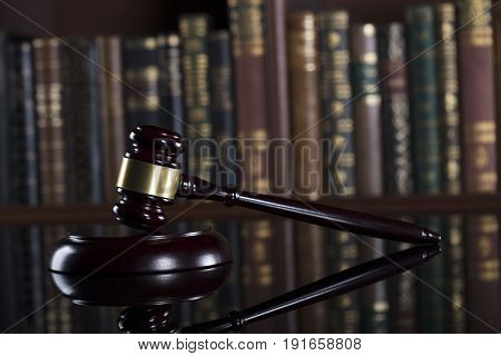 Mallet of judge. Law theme. Court library.
