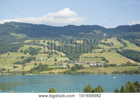 A View of the Houses Overlooking Lac de la Gruyère (Lake of Gruyère) in Switzerland on a Summer Day