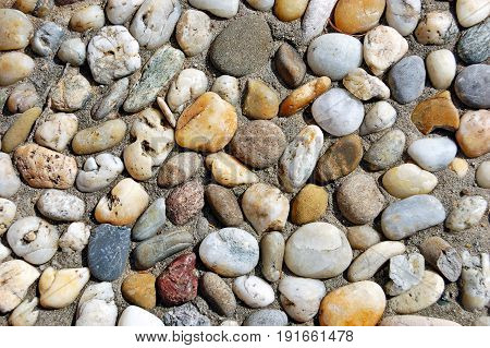 Multicolored pebble stones texture useful as natural background