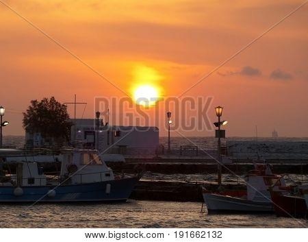 Beautiful sunset at the Old Port of Mykonos, Mykonos island of Greece