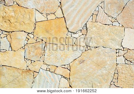 Stone wall made of sandstone pieces of irregular shape