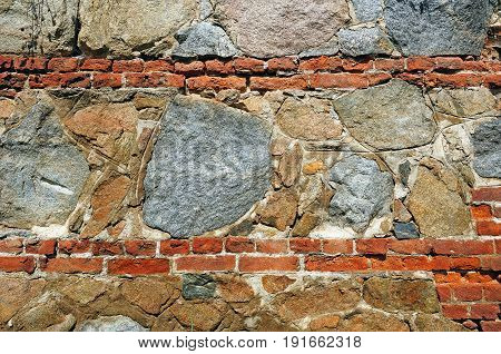 Fragment of wall made of rough unequal stones