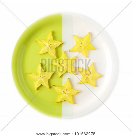 Slices of starfruit (carambola) on a two-colored plate