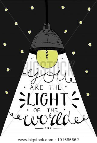 Hand lettering You the light of the world, made on the star background with glowing light bulb. Biblical background. Christian poster.