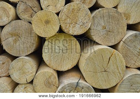 Natural wooden background - chopped firewood. Firewood stacked and prepared for winter. Pile of wood logs closeup.
