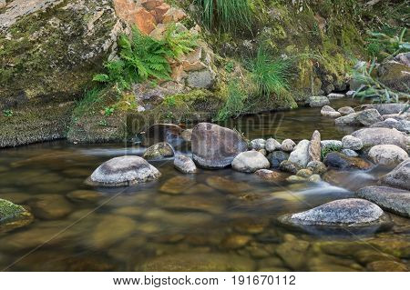 The small rippling side stream of the Ardeche river in France