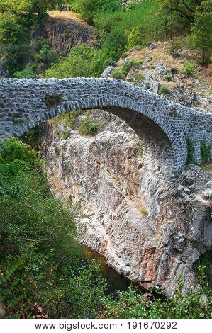 The Pont du Diable or Devil Bridge is a Roman bridge that spans the river Ardeche at about 10 m altitude. The bridge is located near the village of Thueyts in the Ardeche department in France