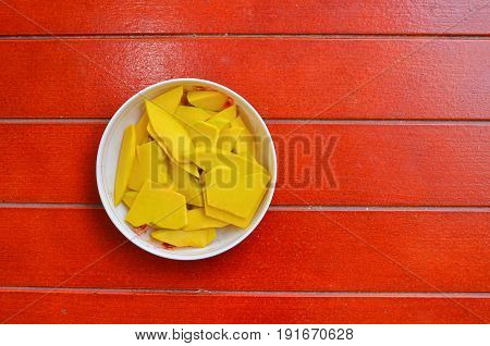 Pumpkin in a dish on a fresh redwood floor healthy for family activities.