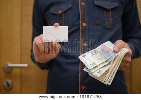 Businessman Holding A Bank Card, And In The Other Hand Holding The Money In Cash, Finance, Businessm