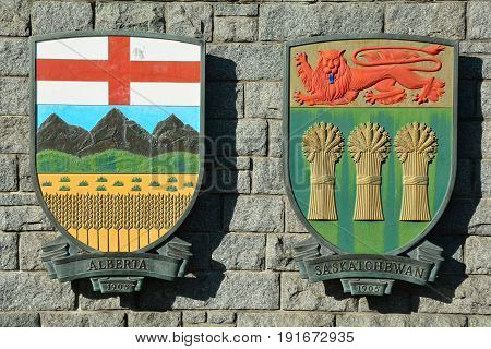 Victoria BC,Canada,March 3rd 2015.The coats of arms for the Canadian provinces of Alberta and Saskatchewan hang on a rock wall in Victoria BC.
