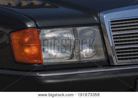 Old car: traditional headlight with halogen bulbs
