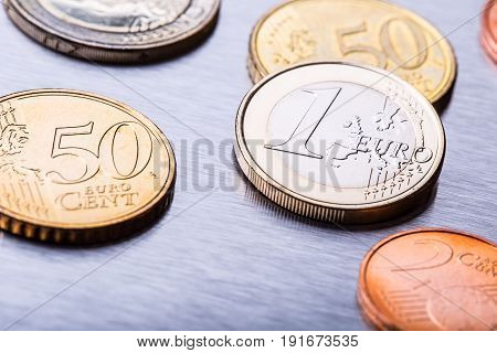 Euro money. Euro currency. Euro coins stacked on each other in different positions.