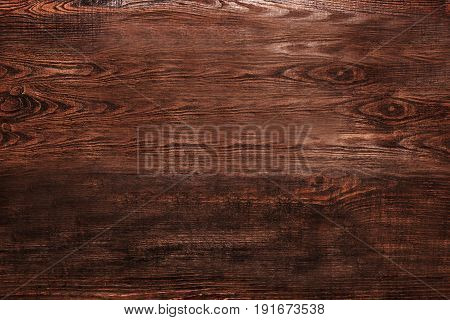 Brown wooden textured background top view. Nobody