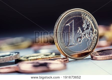 One euro coin on the edge. Euro money currency. Euro coins stacked on each other in different positions.