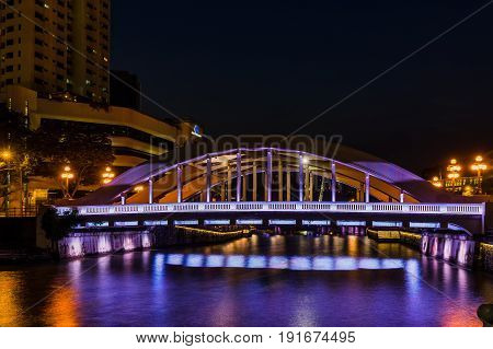Singapore Elgin Bridge And Tourist Boats At Night With Lighting