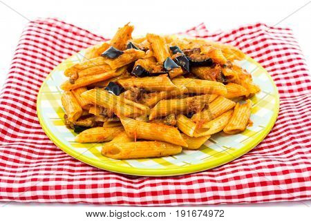 Pasta with aubergine and tomato on a the table